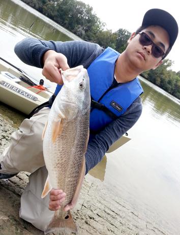 Saya dan ikan redfish pertama saya
