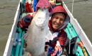 Saya dengan barramundi di Sungai Tabalong